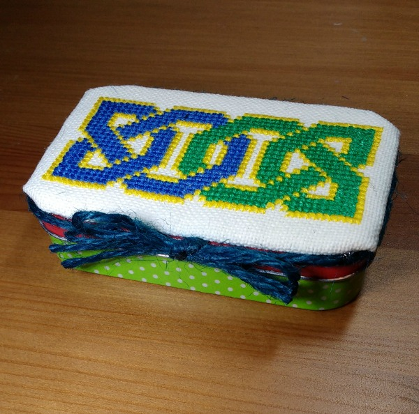 Finished cross-stitch Celtic knot tin topper