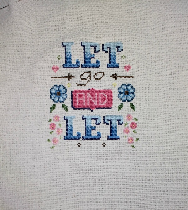 Progress on the Let go and let God cross-stitch pattern