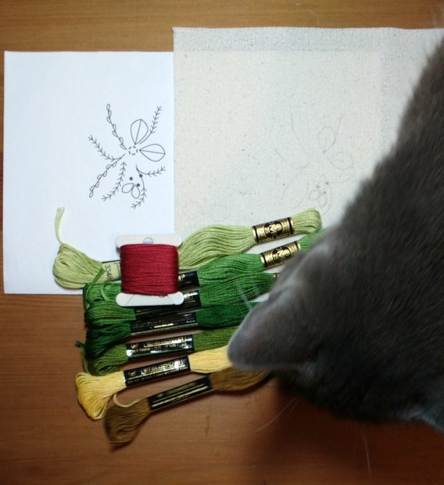 Chi checks out the embroidery threads