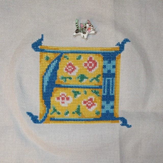 medieval-style cross-stitch letter A progress